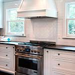 Painted Shaker Kitchen with Custom Hood
